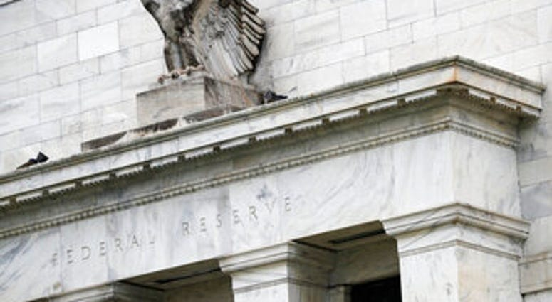 FILE - This May 22, 2020, file photo shows the Federal Reserve building in Washington. (AP Photo/Patrick Semansky, File)