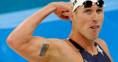 FILE - In this Tuesday, Aug. 12, 2008 file photo, United States' relay swimmer Klete Keller reacts after a men's 4x200-meter freestyle relay heat during the swimming competitions at the Beijing 2008 Olympics in Beijing. (AP Photo/Thomas Kienzle, File)