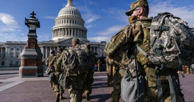 National Guard troops reinforce security around the U.S. Capitol ahead of expected protests leading up to President-elect Joe Biden's inauguration. (AP Photo/J. Scott Applewhite)