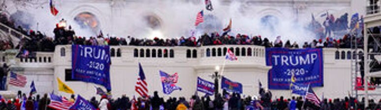 FILE - In this Jan. 6, 2021, file photo violent rioters, loyal to President Donald Trump, storm the Capitol in Washington. (AP Photo/John Minchillo, File)