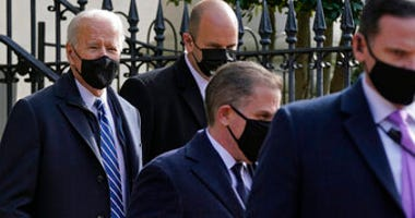 President Joe Biden departs after attending mass at Holy Trinity Catholic Church, Sunday, Jan. 24, 2021, in the Georgetown neighborhood of Washington. (AP Photo/Patrick Semansky)