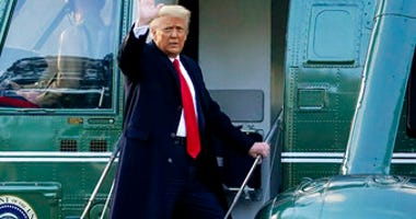 FILE - In this Wednesday, Jan. 20, 2021, file photo, President Donald Trump waves as he boards Marine One on the South Lawn of the White House, in Washington. (AP Photo/Alex Brandon, File)