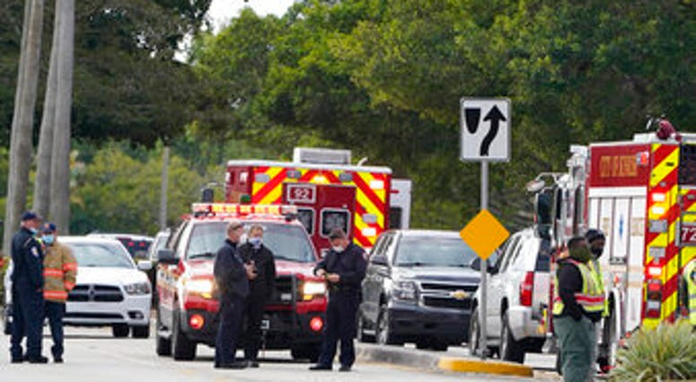 Law enforcement officers block an area where a shooting wounded several FBI while serving an arrest warrant, Tuesday, Feb. 2, 2021, in Sunrise, Fla. (AP Photo/Marta Lavandier)