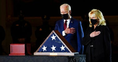 President Joe Biden and first lady Jill Biden pay their respects to the late U.S. Capitol Police officer Brian Sicknick. (Erin Schaff/The New York Times via AP, Pool)