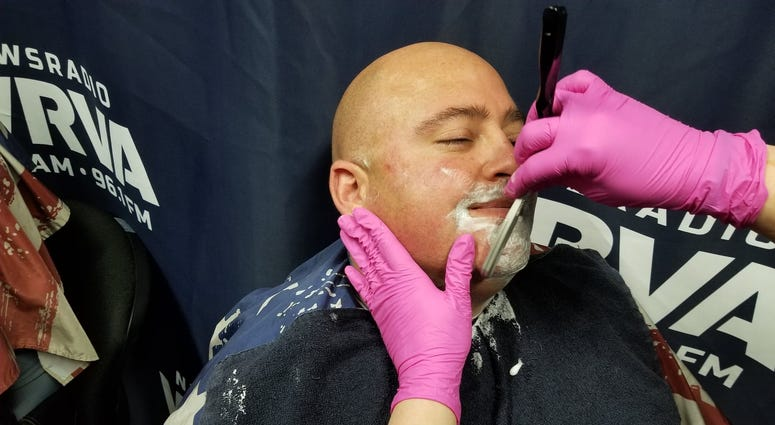Sgt. Pridemore getting shaved