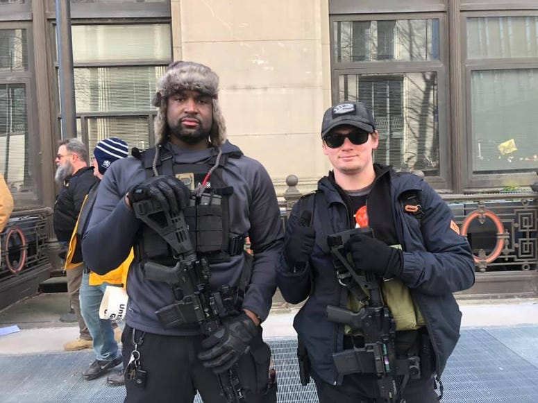 Tayji Tucker of Richmond and  Robert Dean of Harrisonburg show off their weapons during the Gun Rights Rally on Janaury 20,2020. (Matt Demlein, WRVA)