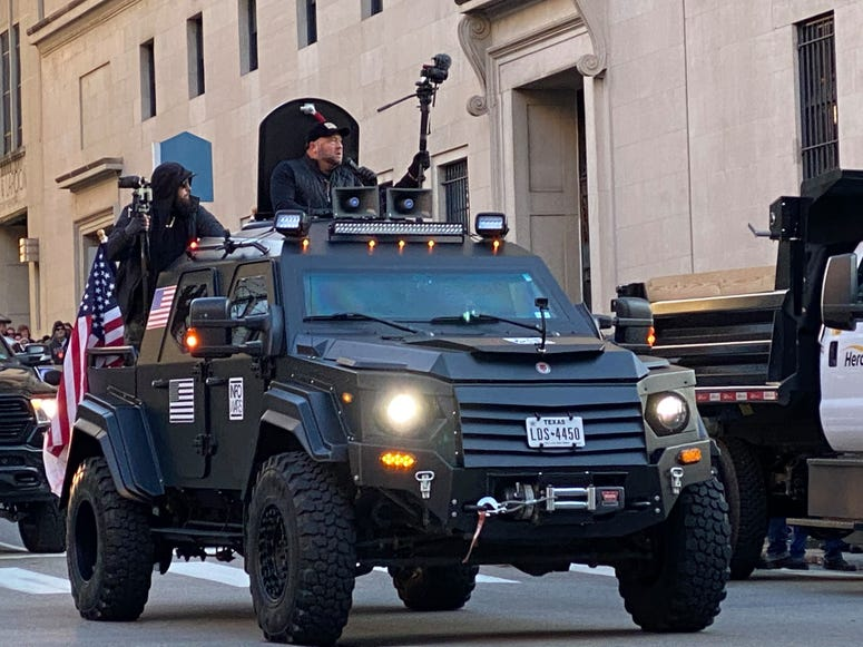 Conservative Talk Host Alex Jones rides through streets of Richmond in a military syle vehicle.  (Jay Hart, WINA)