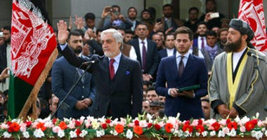 In this Monday, March 9, 2020, photo, Afghanistan's Abdullah Abdullah, front left, greets his supporters after being sworn in as president in Kabul, Afghanistan. (AP Photo)