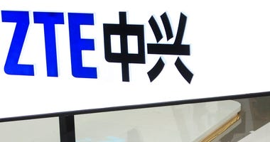 FILE- In this Feb. 26, 2014, file photo, a sign for the ZTE booth is seen at the Mobile World Congress, the world's largest mobile phone trade show in Barcelona, Spain.  (AP Photo/Manu Fernandez, File)