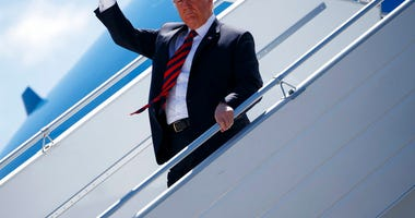 President Donald Trump steps off Air Force One as he arrives for the G7 Summit, Friday, June 8, 2018, in Canadian Forces Base Bagotville, Canada. (AP Photo/Evan Vucci)