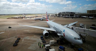In this June 16, 2018 photo, American Airlines aircrafts are seen at Dallas-Fort Worth International Airport in Grapevine, Texas. (AP Photo/Kiichiro Sato)