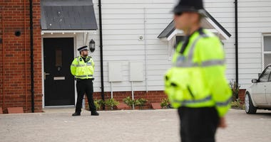 British police officers stand outside a residential property in Amesbury, England, Wednesday, July 4, 2018 .(AP Photo/Matt Dunham)