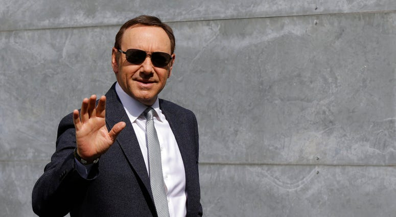 FILE - In this file photo dated Tuesday, June 21, 2016, actor Kevin Spacey waves as he arrives to attend the Giorgio Armani men's Spring-Summer 2016-2017 fashion show in Milan, Italy. (AP Photo/Luca Bruno, FILE)