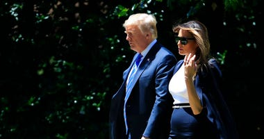 President Donald Trump and first lady Melania Trump, leave the White House in Washington, Wednesday, July 18, 2018, as they travel to to Andrews Air Force Base to pay their respects.(AP Photo/Manuel Balce Ceneta)