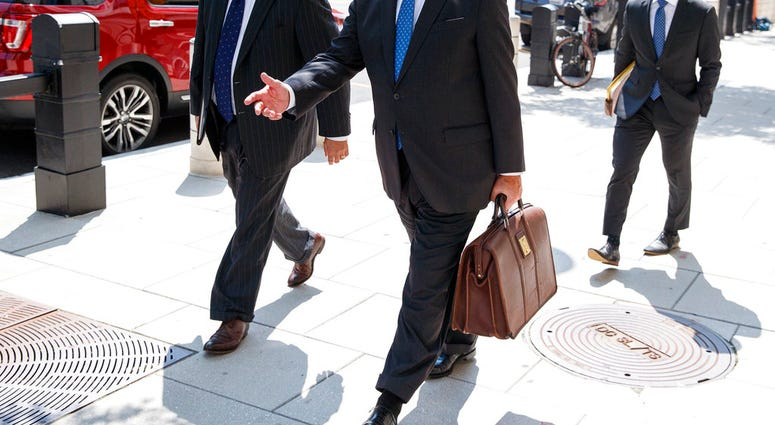 Richard Westling, left, and Thomas Zehnle, center, with the defense team for Paul Manafort, leave federal court in Washington, Tuesday, Aug. 28, 2018.(AP Photo/Carolyn Kaster)