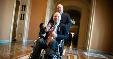 FILE - In this Dec. 1, 2017, file photo, Sen. John McCain, R-Ariz., leaves a closed-door session on Capitol Hill in Washington.  (AP Photo/J. Scott Applewhite, File)
