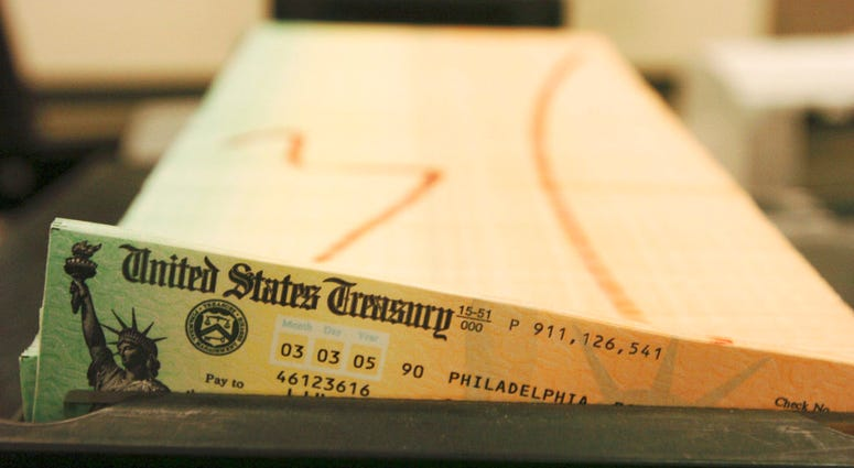 Trays of printed social security checks wait to be mailed from the U.S. Treasury's Financial Management services facility in Philadelphia.(AP Photo/Bradley C. Bower, File)