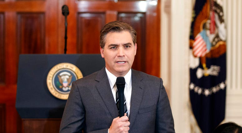 FILE - In this Nov. 7, 2018, file photo, CNN journalist Jim Acosta does a standup before a new conference with President Donald Trump in the East Room of the White House in Washington.(AP Photo/Evan Vucci, File)