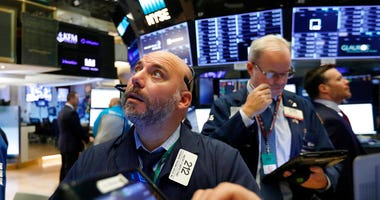 File photo trader Vincent Napolitano, left, works on the floor of the New York Stock Exchange. (AP Photo/Richard Drew, File)