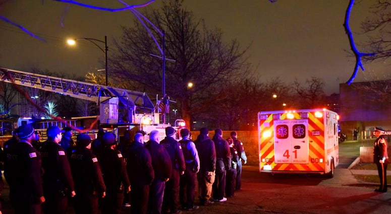 Law enforcement officers including Chicago SWAT work an entrance at Mercy Hospital Monday, Nov. 19, 2018, in Chicago. (AP Photo/Richard Drew, File)