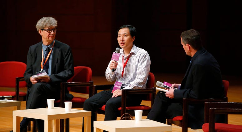 He Jiankui, a Chinese researcher, center, speaks during the Human Genome Editing Conference in Hong Kong, Wednesday, Nov. 28, 2018.(AP Photo/Kin Cheung)
