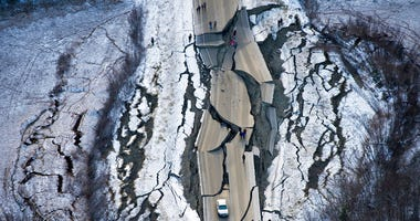 This aerial photo shows damage on Vine Road, south of Wasilla, Alaska, after earthquakes Friday, Nov. 30, 2018. (Marc Lester/Anchorage Daily News via AP)