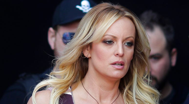 """FILE - In this Oct. 11, 2018, file photo, adult film actress Stormy Daniels arrives for the opening of the adult entertainment fair """"Venus,"""" in Berlin.(AP Photo/Markus Schreiber, File)"""