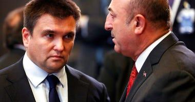 Turkish Foreign Minister Mevlut Cavusoglu, right, speaks with Ukraine's Foreign Minister Pavlo Klimkin. (AP Photo/Francisco Seco)