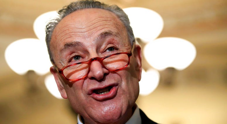 FILE - In this Dec. 11, 2018, file photo, Senate Minority Leader Chuck Schumer, D-N.Y., speaks to reporters on Capitol Hill in Washington.  (AP Photo/Manuel Balce Ceneta, File)