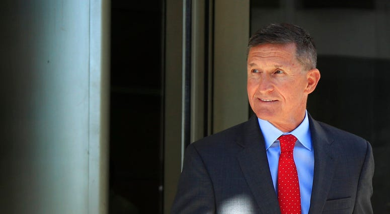 FILE - In this July 10, 2018, file photo, former Trump national security adviser Michael Flynn leaves the federal courthouse in Washington, following a status hearing.  (AP Photo/Manuel Balce Ceneta, File)