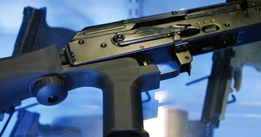 "A little-known device called a ""bump stock"" is attached to a semi-automatic rifle at the Gun Vault store and shooting range in South Jordan, Utah.  (AP Photo/Rick Bowmer)"