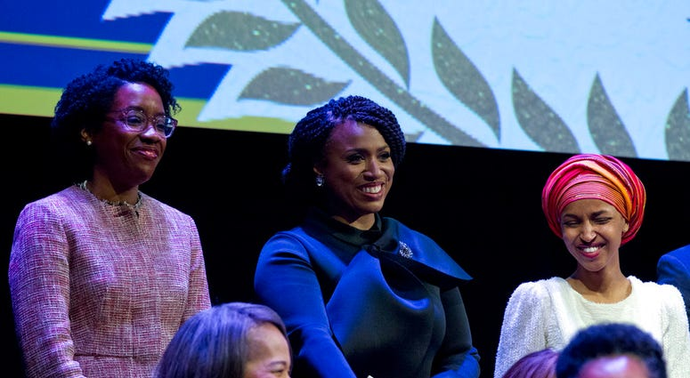From left, Lauren Underwood D-IL, Ayanna Pressley, D-Mass., and Ilhan Omar D-MN, during the swearing-in ceremony of Congressional Black Caucus members of the 116th Congress at The Warner Theatre in Washington. (AP Photo/Jose Luis Magana)