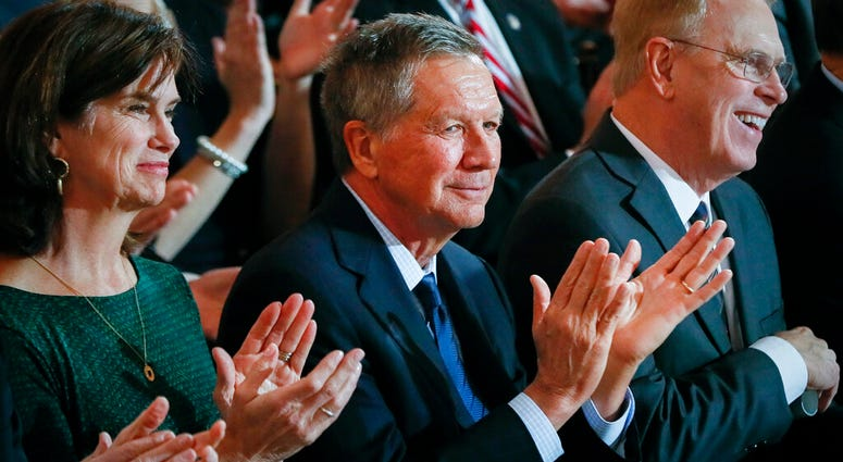 In this Monday, Jan. 14, 2019 photo, former Ohio Gov. John Kasich applauds during a public inauguration ceremony for Gov. Mike DeWine at the Ohio Statehouse, in Columbus, Ohio. (AP Photo/John Minchillo)