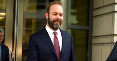 FILE - In this Feb. 23, 2018 file photo, Rick Gates leaves federal court in Washington. (AP Photo/Jose Luis Magana)