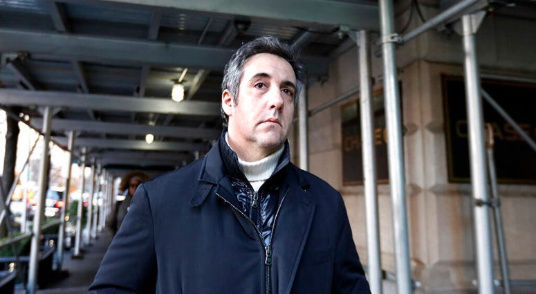 FILE - In this Dec. 7, 2018 file photo, Michael Cohen, former lawyer to President Donald Trump, leaves his apartment building in New York.  (AP Photo/Richard Drew, File)