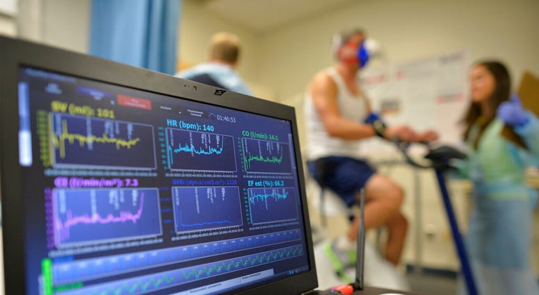 FILE - In this Aug. 27, 2014 file photo, a laptop computer monitors a patient's heart function as he takes a stress test while riding a stationary bike in Augusta, Ga. (AP Photo/The Augusta Chronicle, Michael Holahan)
