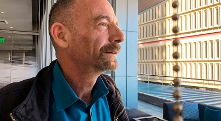 """Timothy Ray Brown poses for a photograph, Monday, March 4, 2019, in Seattle. Brown, also known as the """"Berlin patient,"""" was the first person to be cured of HIV infection, more than a decade ago. (AP Photo/Manuel Valdes)"""