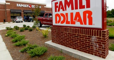FILE - This Aug. 19, 2014 photo shows the Family Dollar store in Ridgeland, Miss. Dollar Tree is closing up to 390 Family Dollar stores this year and rebranding about 200 others under the Dollar Tree name.  (AP Photo/Rogelio V. Solis, File)