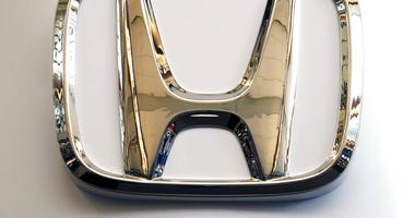 In this Feb. 14, 2019, photo, this photo shows the Honda logo on a sign at the 2019 Pittsburgh International Auto Show in Pittsburgh.(AP Photo/Gene J. Puskar)