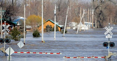 A railroad crossing is flooded with water from the Platte River, in Plattsmouth, Neb., Sunday, March 17, 2019. (AP Photo/Nati Harnik)