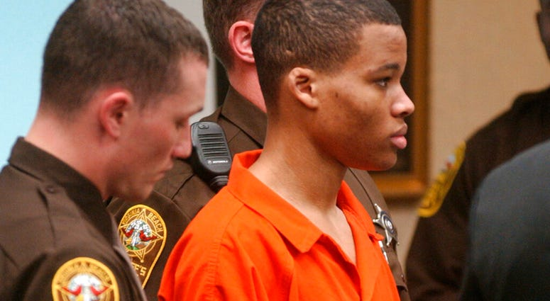 FILE - In this Oct. 20, 2003 file photo, Lee Boyd Malvo listens to court proceedings during the trial of fellow sniper suspect John Allen Muhammad in Virginia Beach, Va.  AP Photo/Martin Smith-Rodden, Pool, File)