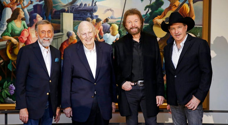 Ray Stevens, from left, Jerry Bradley, Ronnie Dunn, and Kix Brooks pose at a press conference announcing that they will be inducted into the Country Music Hall of Fame Monday, March 18, 2019, in Nashville, Tenn. (AP Photo/Mark Humphrey)