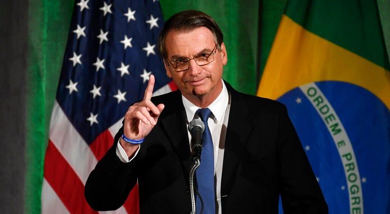 Brazilian President Jair Bolsonaro speaks at the Chamber of Commerce in Washington, Monday, March 18, 2019. (AP Photo/Susan Walsh)