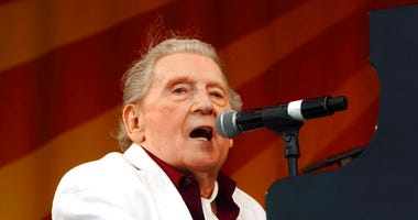 FILE - In this May 2, 2015 file photo, Jerry Lee Lewis performs at the New Orleans Jazz & Heritage Festival in New Orleans.  Photo by John Davisson/Invision/AP, File)