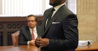 R. Kelly appears for a hearing at the Leighton Criminal Court Building on Friday, March 22, 2019 in Chicago.  (E. Jason Wambsgans/Chicago Tribune via AP, Pool)