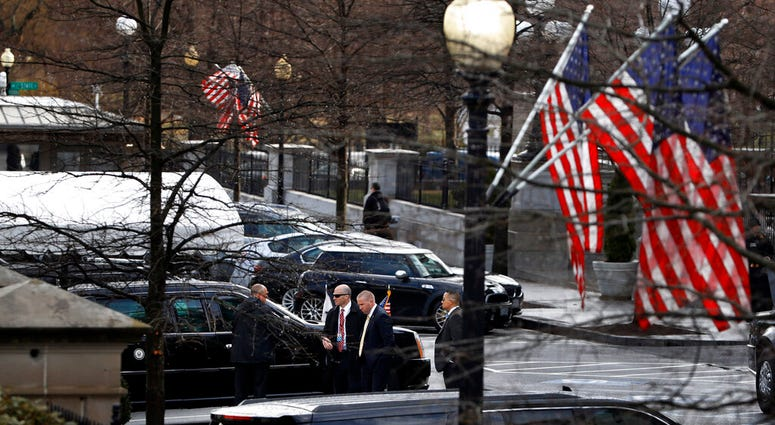 Secret Service Agents and staff stand by the limo of Vice President Pence.(AP Photo/Jacquelyn Martin)