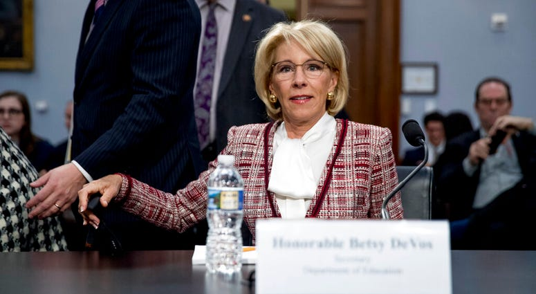 Education Secretary Betsy DeVos arrives for a House Appropriations subcommittee hearing on budget on Capitol Hill in Washington, Tuesday, March 26, 2019. (AP Photo/Andrew Harnik)