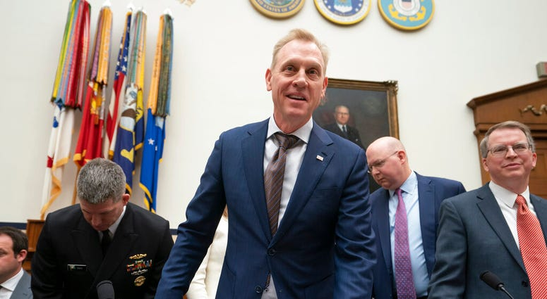Acting Defense Secretary Patrick Shanahan and David Norquist, far right, the Defense Department's budget chief.  (AP Photo/J. Scott Applewhite)