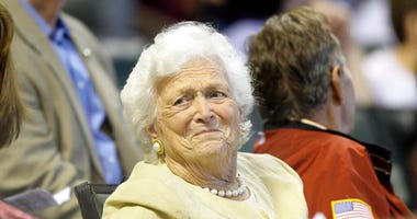 FILE- This April 18, 2009 file photo shows former first lady Barbara Bush during the third inning of a Major League Baseball game in Houston. (AP Photo/David J. Phillip, File)