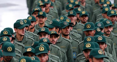 FILE - In this Feb, 11, 2019 file photo, Iranian Revolutionary Guard members arrive for a ceremony celebrating the 40th anniversary of the Islamic Revolution.  (AP Photo/Vahid Salemi)